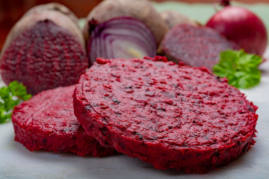 Healthy vegetarian food, raw round burgers made from red beetroot