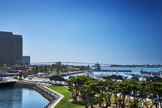 San Diego's waterfront at Tuna Harbor Park with Coronado and the Bay Bridge in the distance