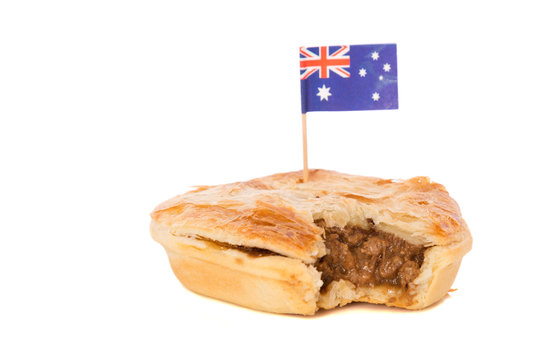 A traditional meat pie with a bite taken out of it.