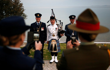New Zealand soldiers pose for a souvenir picture after a dawn ceremony marking the 104th anniversary of the World War One battle of Gallipoli, at Anzac Cove in Canakkale