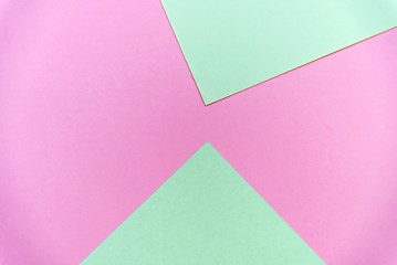 Abstract pastel green and pink pastel color paper geometric flat lay background