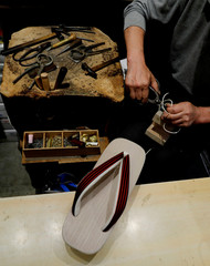 A craftsman makes Geta, a traditional Japanese wooden sandals at Tsujiya, the traditional footwear shop which has more than one hundred year history in Tokyo