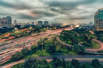 Fototapete - Sunset over Jakarta city downtown