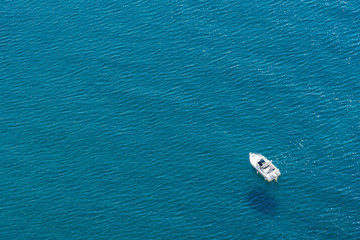 Motor boat in bright blue sea concept of active recreation, holidays by the sea, entertainment and sea transport, fishing, copy space