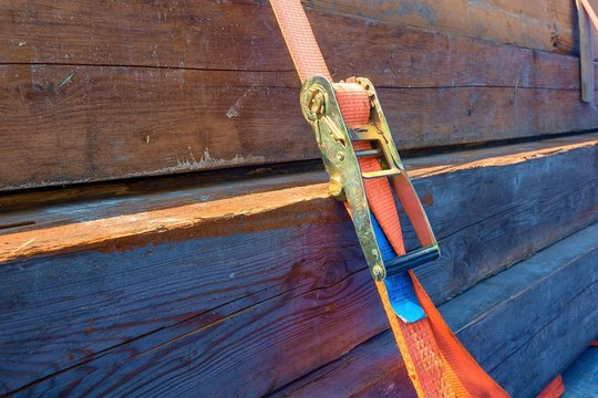a cargo secured with a orange tension belt