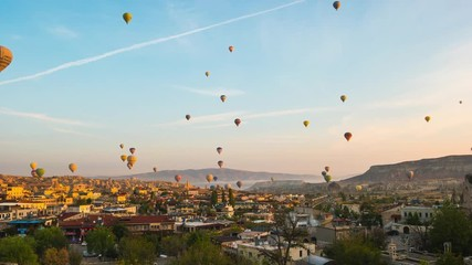 Wall Mural - Sunrise in Cappadocia with flying balloon in Cappadocia city skyline in Goreme, Turkey time lapse