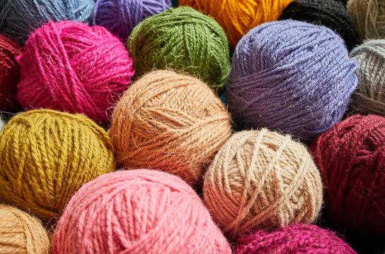 Colorful wool yarn balls, shallow depth of field..