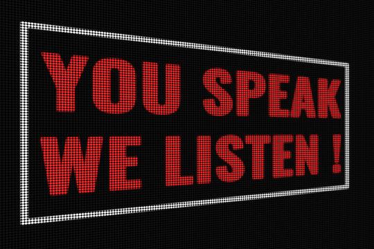 You speak we listen red words on dark screen