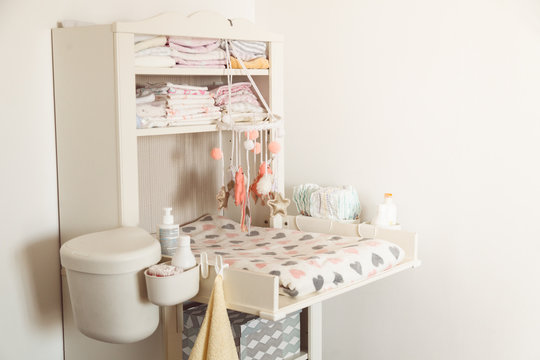Baby changing table in light bedroom