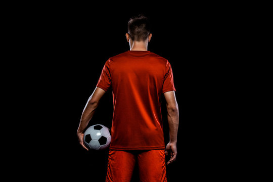 Teenager - soccer player. Boy in football sportswear after game with ball. Sport concept.