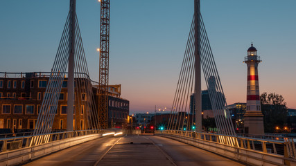 An evening landscape of Malmo - with bridge constructions and a lighthouse