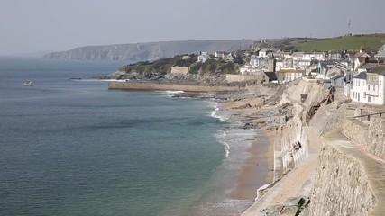 Wall Mural - Porthleven Cornwall coast view towards the town with beach and waves