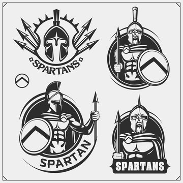 Set of spartans emblems and labels. Sport club design elements and templates. Ancient warriors, spartan spirit, gladiator helmets.