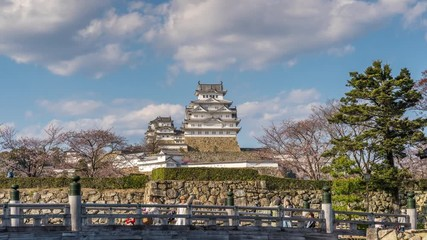 Wall Mural - Time lapse of castle and clouds in Himeji, Japan.