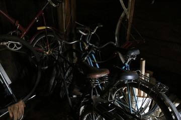 Aluminium Prints Bicycle old bicycles and tools in the garage, shed