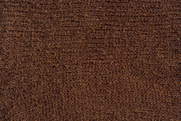 Brown knitted fabric texture. Knitted abstract background chocolate color. Dark brown fabric. Wall mural