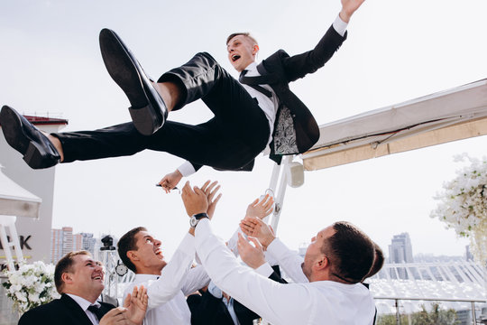 Friends congratulate the groom.