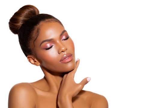 beauty porter young dark skinned girl with perfect skin and makeup. bridal makeup - delicate pink tones, wet make-up, shine. sexy plump lips. hair gathered in the bun on his head.  - Image.