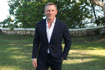 """Actor Daniel Craig poses for a picture during a photocall for the British spy franchise's 25th film set for release next year, titled """"Bond 25"""" in Oracabessa"""