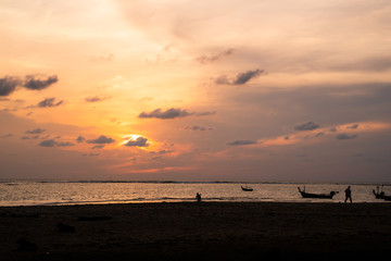 Background sky sunset,Silhouette Thai boat love travel to the beach adventure,Bright in Phuket Thailand.