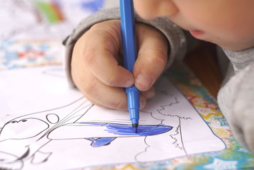 the child draws coloring close up
