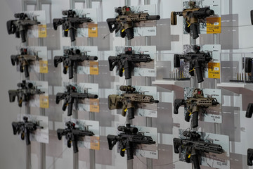 A wall of semi-automatic rifles hang on display inside the Indiana Convention Center as part of the annual National Rifle Association (NRA) convention in Indianapolis, Indiana