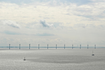 Ocean wind turbines near the port of Copenhagen, Denmark. Renewable energy concept image.
