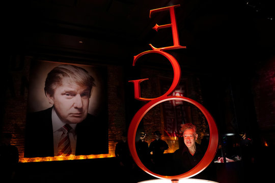 Artist-provocateur Andres Serrano poses for a portrait in a gallery that houses his take on U.S. President Donald Trump with a new exhibit called The Game: All Things Trump in New York
