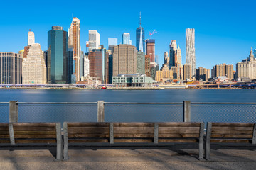 Wall Mural - Scene of New york Cityscape river side with east river at the morning time under blue sky, USA downtown skyline, Architecture and building with tourist concept