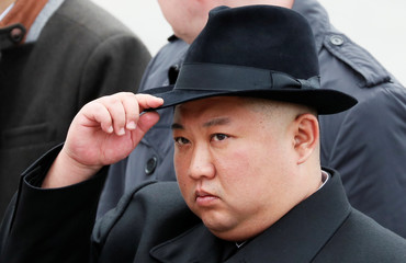 North Korean leader Kim Jong Un attends a wreath laying ceremony at a navy memorial in Vladivostok
