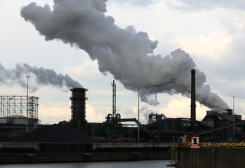 Smoke is seen coming out of chimneys at the Tata steel plant in Ijmuiden