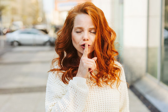 Young woman asking for silence or secrecy