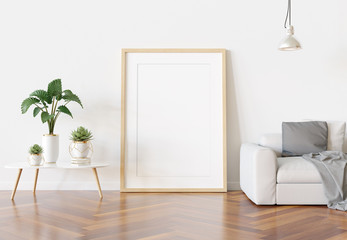 Wooden frame leaning in bright white living room with plants and decorations mockup 3D rendering