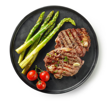 plate of grilled steaks on white background