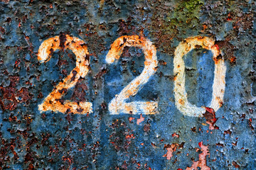 220 on a rusty metal wall. grunge Wall mural