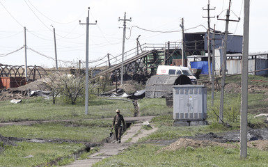 A miner walks at a coal mine following a methane explosion near Luhansk