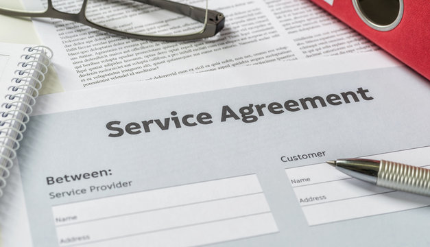 A Service agreement with a pen on a desk