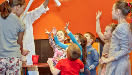 Chemical show for kids. Professor carried out chemical experiments with liquid nitrogen on Birthday...