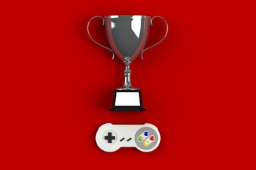 Video game console GamePad. Gaming concept. Top view retro joystick with trophy isolated on red background, 3D rendering