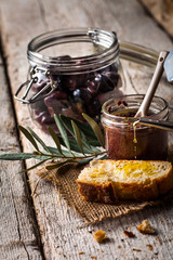 olives, olive oil on bread and olive paste