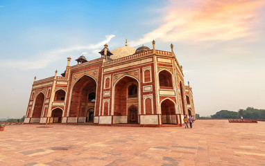 Fototapete - Humayun Tomb Delhi red sandstone architecture primary structure at sunset with moody sky