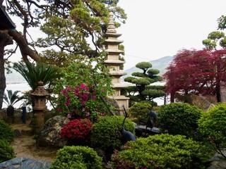 Japanese Stone Pagoda in a Spring Garden