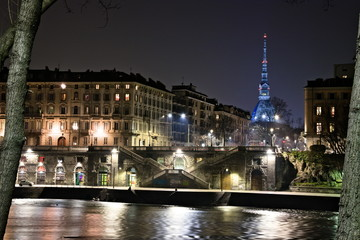 Recess Fitting Paris View on the Po riversides in Turin, with Mole Antonelliana illuminated by special blue lights, in the night, Po river in foreground