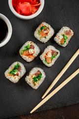 Foto op Aluminium Sushi bar Japanese sushi on a rustic dark background.