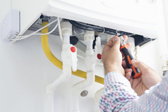 Technician repairing gas heater at home