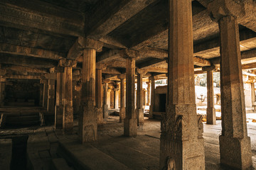 Standing old columns in a ancient temple in Hampi