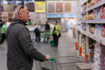 the man is shopping in the hardware store