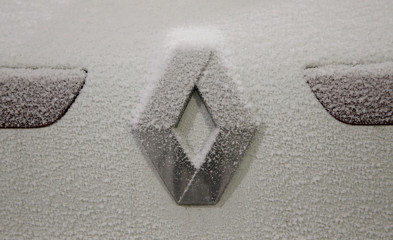 The logo of French car manufacturer Renault is seen during a snow test at the Jules Verne climatic wind tunnel at the Scientific and Technical Center for Building (CSTB) research laboratory in Nantes