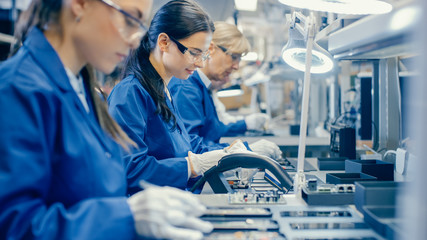 Women working in electronics factory