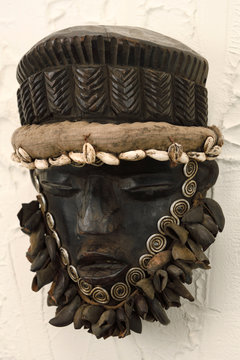 West African wood carved Dan Ceremonial dance mask with shells